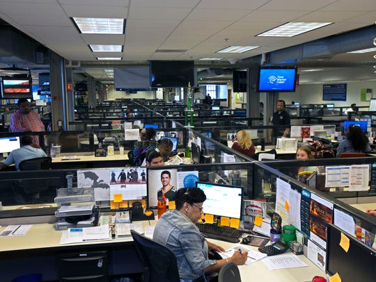 Workers answer customers' calls at the former Time Warner Cable call center in Milwaukee, now run by Charter Communications.