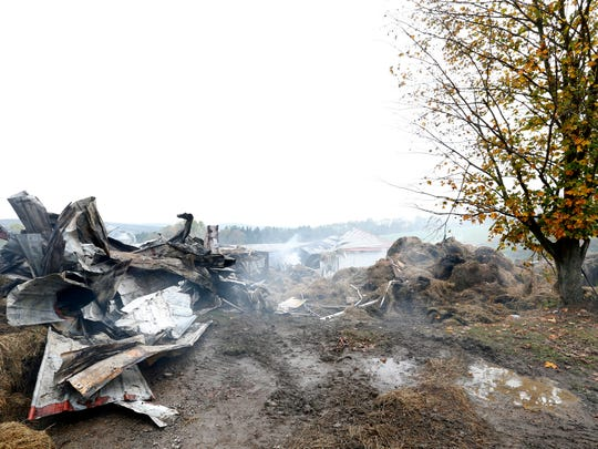Smoking debris at Aukema Dairy Farm in Chenango Forks on Wednesday October 11, 2017.  A fire engulfed the dairy barn on Tuesday evening.