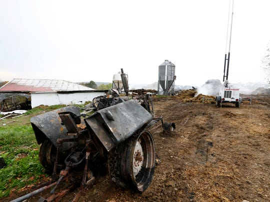 A scorched tractor which was pulled from the dairy