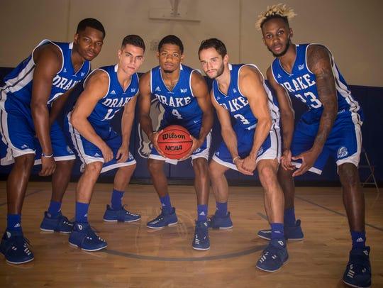 Drake seniors, C.J. Rivers, left, Reed Timmer, De'Antae