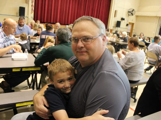 Third grader Nathan Testerman hugs his grandfather, his Very Important Person.