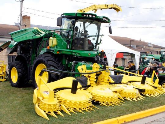 Visitors to World Dairy Expo check out equipment on Oct. 7, 2017, at the Alliant Energy Center in Madison.