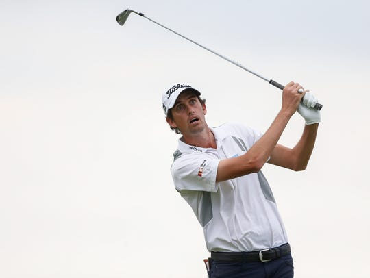 Chesson Hadley watches his tee shot on the sixteenth hole during the third round at Sea Island Golf Club - Seaside Course.