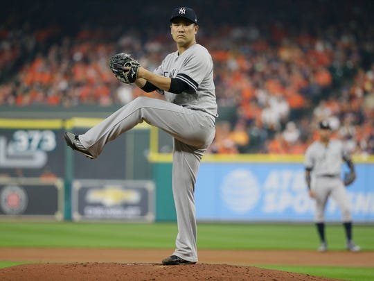 New York Yankees starting pitcher Masahiro Tanaka throws during the second inning of Game 1 of baseball's American League Championship Series against the Houston Astros Friday, Oct. 13, 2017, in Houston.