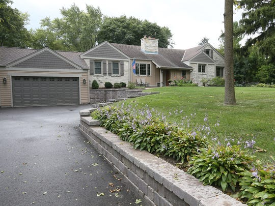 A two-car garage was added to the front of the Pfeiffer home in Elm Grove.