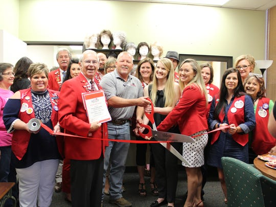 Members of the Abilene Chamber of Commerce Redcoats celebrate the opening of the American Cancer Society's new Cancer Resource Center on Sept. 8.