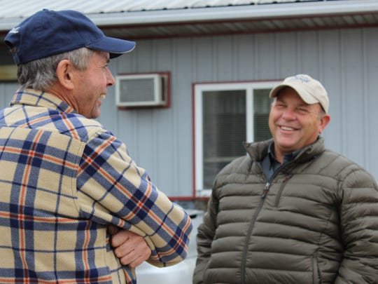 Soaring Eagle Dairy founder Jim Fitzgerald (left) chats with AFBF President Zippy Duvall during a visit to his farm.