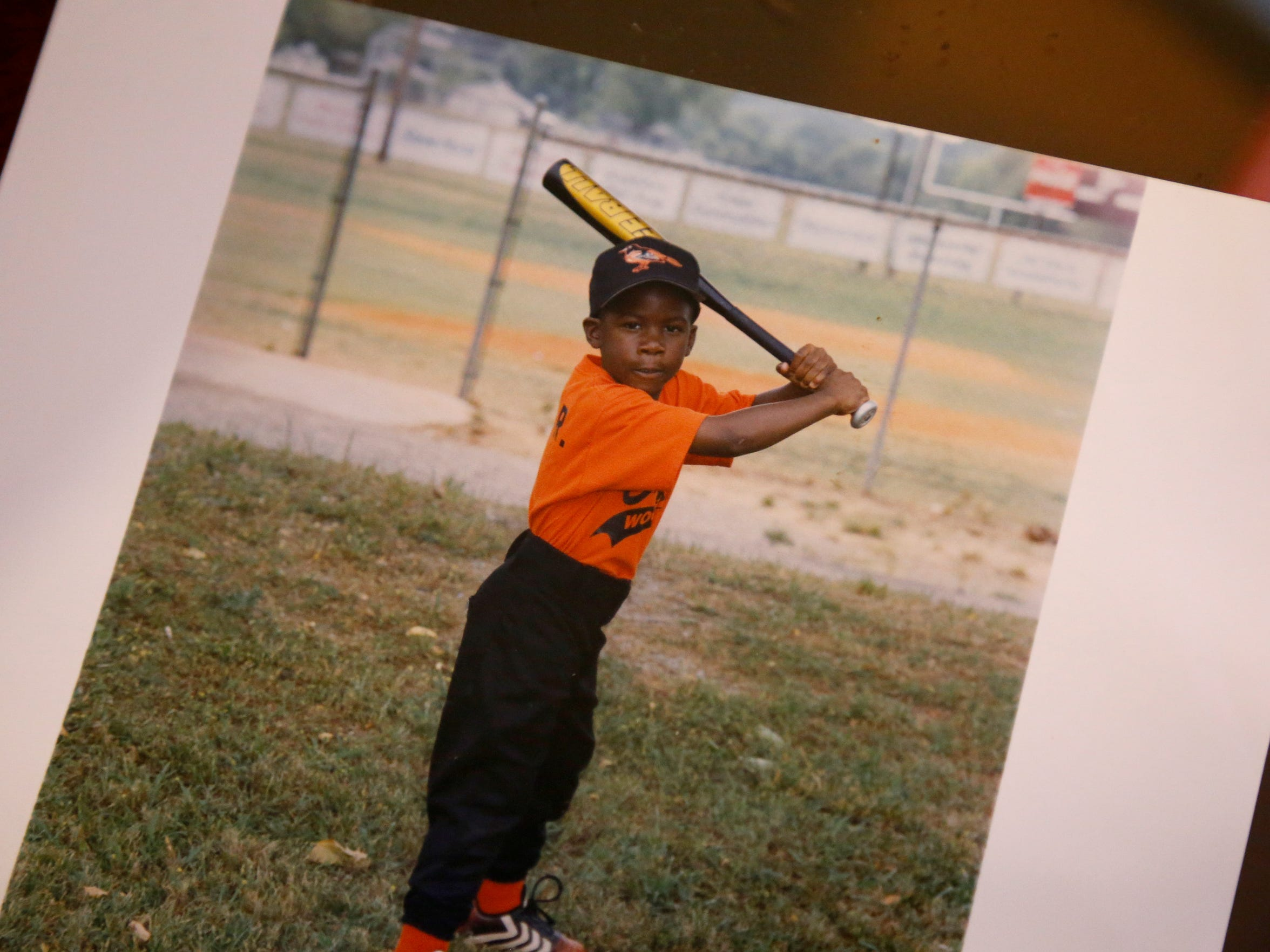 Young Shed Long playing baseball at his parents home in Talladega, Ala.