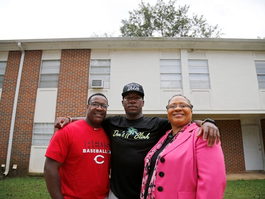 Long poses with his parents Shed Sr. and Lisa Long outside at their home in Talladega, Ala.