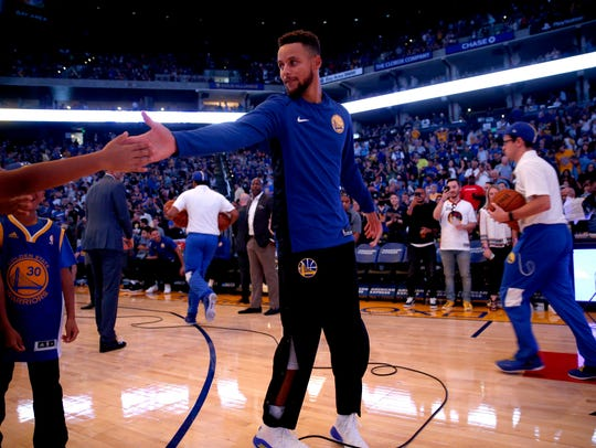 Golden State Warriors guard Stephen Curry (30) greets