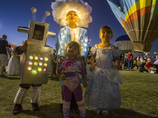 Miles Anderson, Mason Anderson, Alyssa Davids and Jasmyn Davids enjoy the Salt River Fields Balloon Spooktacular at Salt River Fields at Talking Stick in Scottsdale on Friday, Oct. 23, 2015.