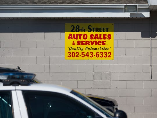 Police investigate the scene of the shooting at 28th Street Auto Sales and Services on the corner of E 28th and Northeast Boulevard Oct. 2017 in Wilmington.