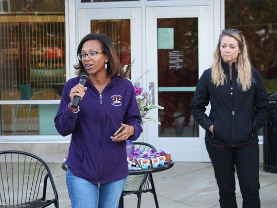 Angel Ross-Taylor shares her story of domestic violence during a candlelight vigil on Thursday, Oct. 19, 2017. October is Domestic Violence Awareness Month.