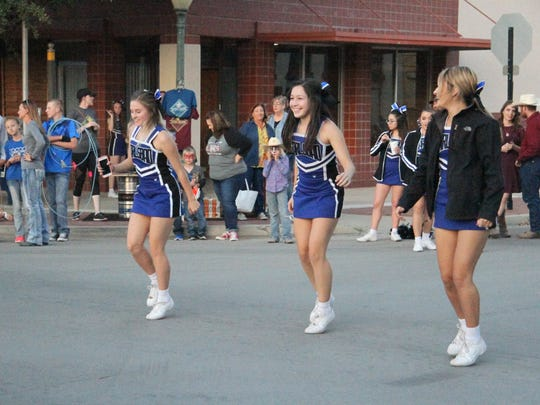 Carlsbad High School cheerleader dance during the first