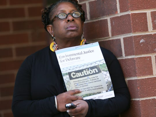 Michele Roberts holds a copy of a report detailing