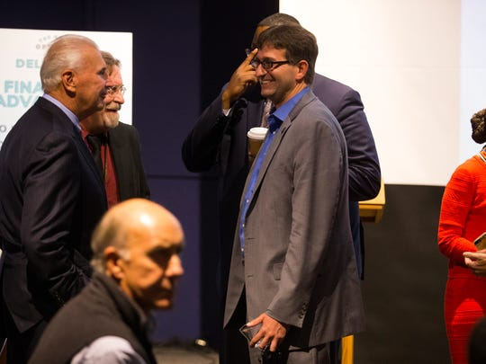 New Castle County Executive Matt Meyer, right, speaks with Wilmington Mayor Mike Purzycki, left, before Gov. John Carney presented the state's bid for the new Amazon headquarters at the Delaware Contemporary.