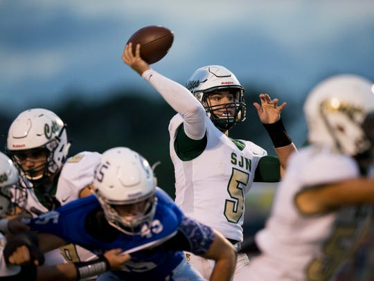 St. John Neumann quarterback Jensen Jones (5) throws the ball against Community School of Naples in the first half of action at Community School of Naples on Oct. 20.
