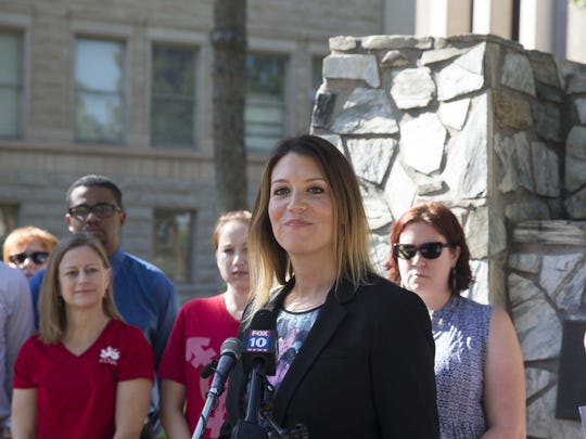 Amy Ball, kindergarten teacher in Madison School District and president of the Madison District Classroom Teachers Association, speaks to the media at the Capitol to seek the kind of raises (20 percent) that Gov. Doug Ducey has given his staff and other executives who work for him.