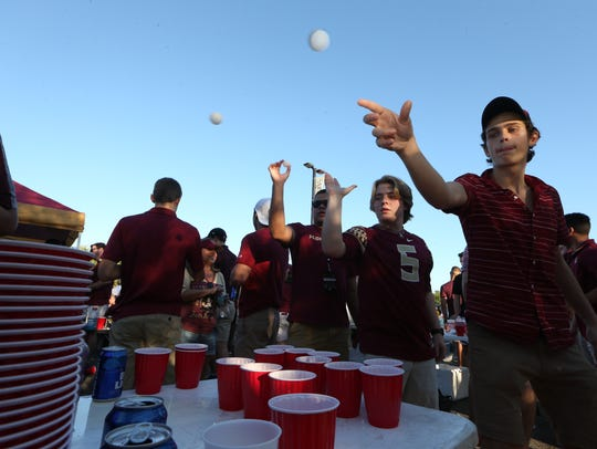 A group of students plays beer pong outside of Doak
