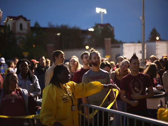 Fans line up at the gate more than two hours before kickoff for a nighttime matchup against the Florida Gators at Doak Campbell Stadium on Saturday, Nov. 26, 2016.