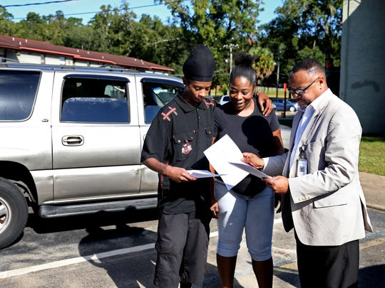 Jermaine Coe (left) and Shanteria Pooe talk to Kimball Thomas about TEMPO, COT's new program aimed at reaching disconnected youth, outside Magnolia Terrace Apartments Oct 12. Coe left school after eighth grade, Pooe after ninth. Pooe is almost nine months pregnant.