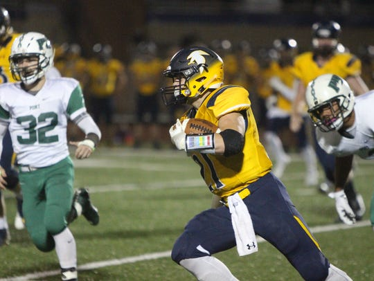 Andrew Mallmann darts up the field for Whitnall on