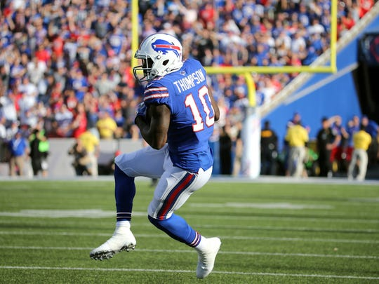 Bills receiver Deonte Thompson  makes one of his four