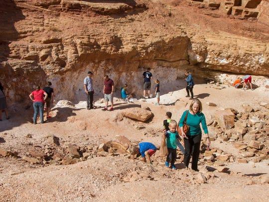 "Visitors gather gypsum at ""Glitter Mine"", an active"