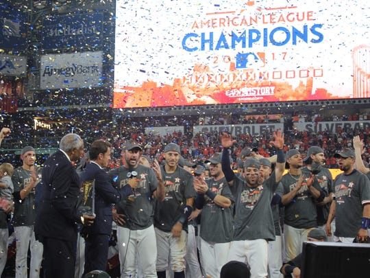 Alex Bregman (center) celebrates an American League pennant with his Houston Astros teammates on Saturday at Minute Maid Park.