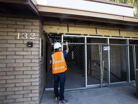 Construction manager David Bosak Jr. gives a tour at