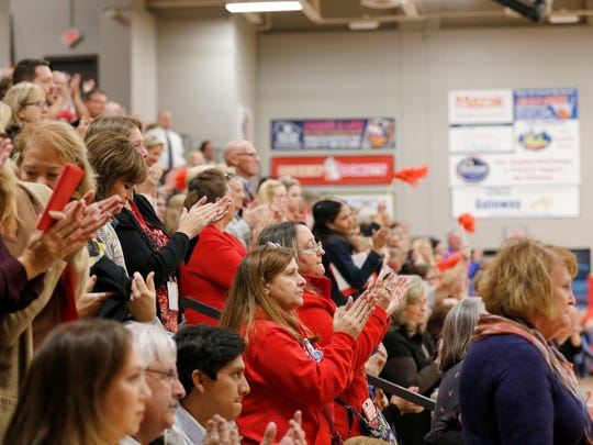 The crowd gives a standing ovation as Dr. Henry Webb speaks at the Northern Kentucky Rally for Public Pensions at Dixie Heights High School in Edgewood, on Tuesday, Oct. 24, 2017. Hundreds of public school teachers and supporters gathered in the school gym to protest proposed plans to change public pensions.