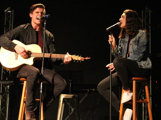 """Jeremiah Miller and Kiersten Dawson perform at Heartland Church on Monday, Oct. 23, 2017. The couple met while auditioning for """"The Voice."""""""