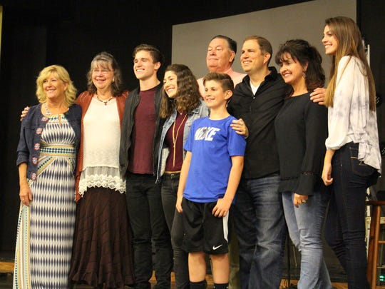 """Kiersten Dawson and Jeremiah Miller pose for photos with family Monday, Oct. 23, 2017. The couple met while auditioning for """"The Voice."""""""