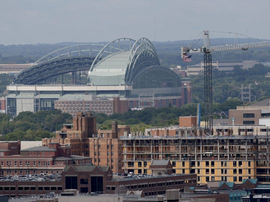 Miller Park where the Milwaukee Brewers baseball team play is seen along with the Marquette University new residence hall facility under construction, located just south of Wells Street between 17th and 18th Streets. -  Photo by Mike De Sisti / Milwaukee Journal Sentinel
