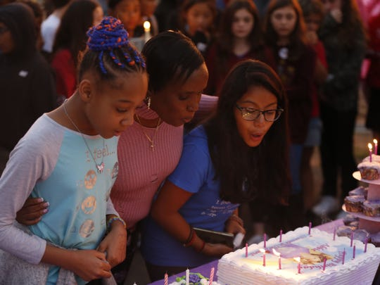 Iman, Carol Bennett and Bridget blow out candles on