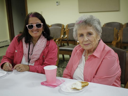 Three Pillars' community events coordinator Diane Marshall and resident Donna Winters enjoy the bagel social.