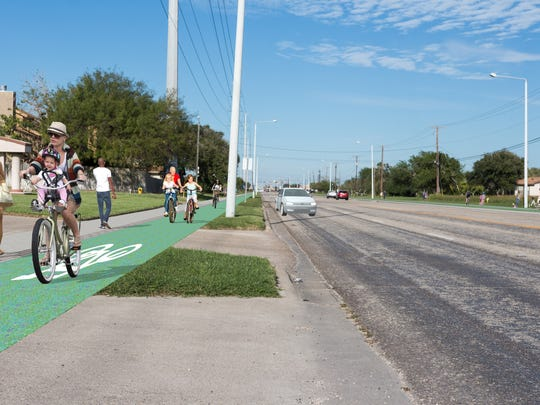 Pictured is a rendering of a proposed cycle track (painted green) that would be constructed along Rodd Field Road. The track is designed to allow the average, everyday person the ability to ride their bikes without impeding pedestrians or being on the street with vehicles.
