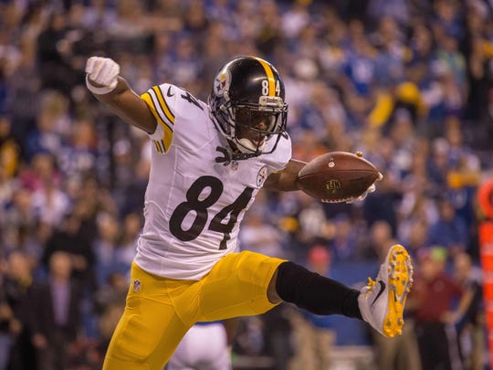 Pittsburgh Steelers wide receiver Antonio Brown (84) celebrates his second touchdown in the first half of the game against the Indianapolis Colts at Lucas Oil Stadium.