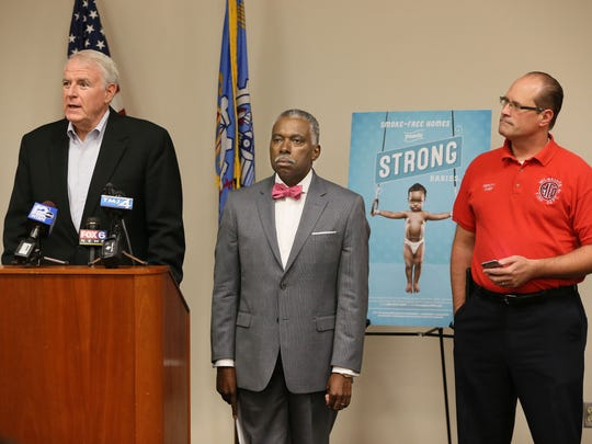 From left, Milwaukee Mayor Tom Barrett; Bevan Baker, city health commissioner; and Aaron Lipski, Milwaukee deputy fire chief talk about smoking and babies during a press conference on the city's Strong Baby campaign Friday.