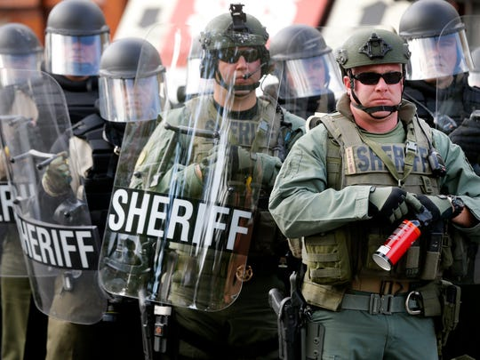 Members of the Rutherford County SheriffÕs Department are in riot gear as they are on stand-by during the White Lives Matter rally on the square in Murfreesboro, on Saturday, Oct. 28, 2017.