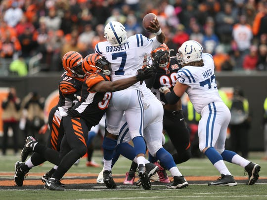 Cincinnati Bengals defensive end Chris Smith (94) hits