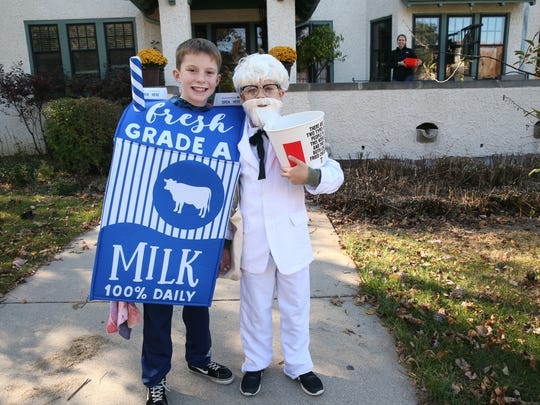 William Travanty (left), 11, and Joseph Phillips, 10, both of Shorewood, head out to trick or treat as Joseph's mom, Cassie Phillips, looks on in the background. They were on Richland Court.