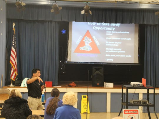 Salinas police volunteer Kevin Low leads a discussion on how to make a neighborhood less vulnerable to criminals Oct. 19 at Kamman Elementary School. It is the first of nine meetings on outreach by city staff.