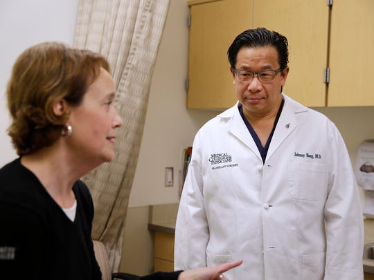 Sara Everts, a recent liver transplant recipient, talks with members of her transplant team including (l-r) Transplant surgeon  Dr. Johnny Hong, during her checkup at The Center for Advanced Care at Froedtert Hospital, Wednesday, October 25, 2017.   For story by from Green Bay  Press Gazette journalist Nate Phelps who is writing series of articles on the unsung hero's of organ transplant. Milwaukee Journal Sentinel photo by Rick Wood/ rgwood@gannett.com