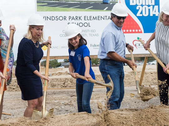 Windsor Park Student Council President Amorie De Leon, 10, (center) helps break ground with CCISD officials during the Windsor Park Elementary ground breaking ceremony  on Tuesday, Oct. 31, 2017.