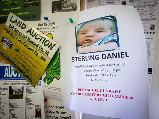 A flier in an Alta Vista convenience store, shown Tuesday, Oct. 31, 2017, in Alta Vista, Iowa, in memorial of the death of an infant in August and arrest of the parents. Cheyanne Renae Harris and Zachary Paul Koehn were arrested on charges of first-degree murder and child endangerment in relation to death of their son Sterling Daniel Koehn.