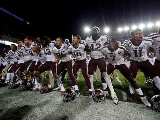 Oct 14, 2017; Gainesville, FL, USA; Texas A&M Aggies running back Keith Ford (7) and teammates celebrate as they beat the Florida Gators during the second half at Ben Hill Griffin Stadium. Mandatory Credit: Kim Klement-USA TODAY Sports