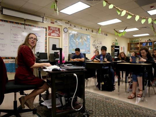 English teacher Sarah Walker reads with her students on Wednesday, Nov. 1, 2017, at Tuloso-Midway High School. She was one of 17 teachers who won the Outstanding Teacher of the Humanities Award from Humanities Texas this year.