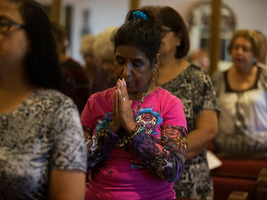 Isabel Castillo prays for loved ones during the annual