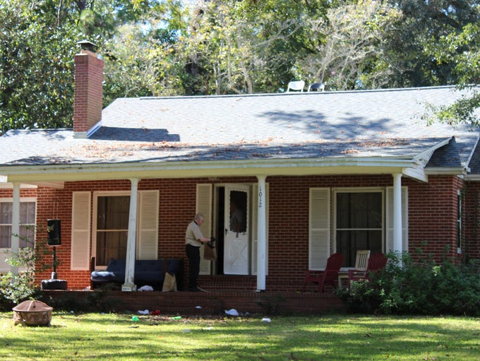 Tallahassee Police investigators collect evidence at
